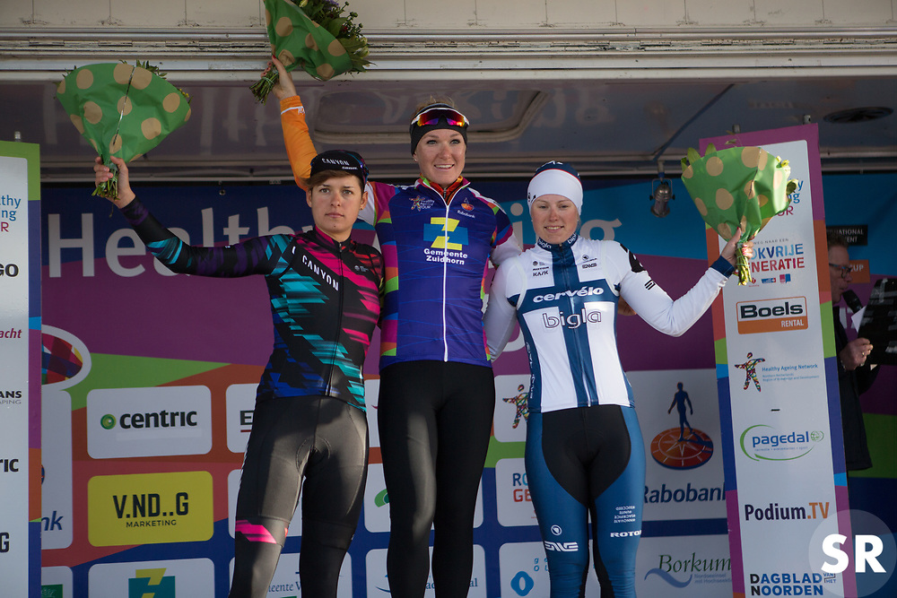 The top three celebrates on the podium of Stage 1b of the Healthy Ageing Tour - a 77.6 km road race, starting and finishing in Grijpskerk on April 5, 2017, in Groeningen, Netherlands.