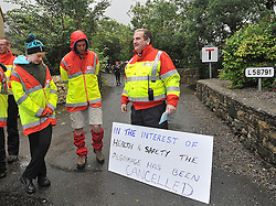 Order of Malta volunteers with a  pilgrimage cancellation notice Croagh Patrick yesterday.<br /> Pic Conor McKeown
