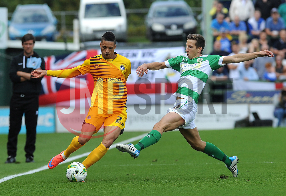 Daniel Leadbitter of Bristol Rovers is challenged by Yeovil Town's Wes Fogden - Mandatory byline: Neil Brookman/JMP - 07966386802 - 15/08/2015 - FOOTBALL - Huish Park -Yeovil,England - Yeovi Town v Bristol Rovers - Sky Bet League One