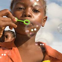 Madagascar <br /> Lydie blowing bubbles.