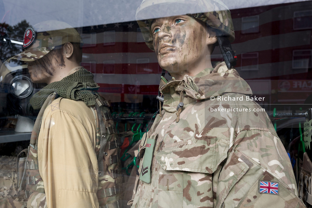 Two mannequins dressed in old British Army uniforms stand in the window of Aaron's Surplus Army & Navy Ltd., on 8th October 2019, in Rainham, Essex, England. Voters in this Havering borough voted 69% in favour of Brexit during the 2016 referendum.