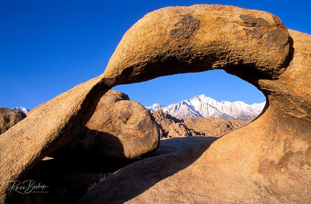 Morning light on Lone Pine Peak through Mobius Arch, Alabama Hills, Sierra Nevada Mountains, California USA