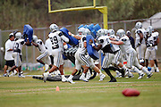 OXNARD, CA - AUGUST 17:  General view of the Dallas Cowboys offensive team working out on the blocking sled during Dallas Cowboys training camp on August 17, 2006 in Oxnard, California. ©Paul Anthony Spinelli