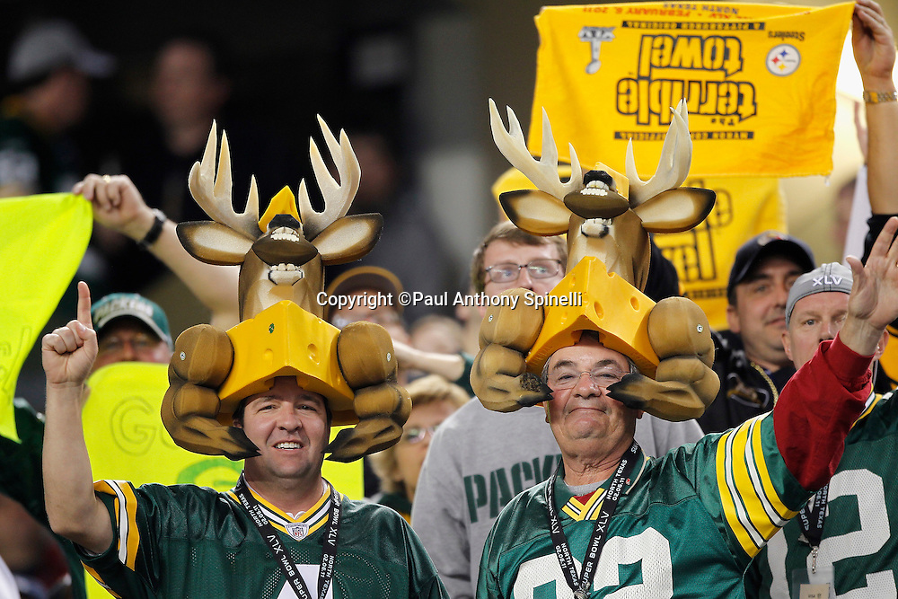 Green Bay Packers fans wearing cheese head hats and antlers wave in celebration after a touchdown during Super Bowl XLV against the Pittsburgh Steelers on Sunday, February 6, 2011, in Arlington, Texas. The Packers won the game 31-25. ©Paul Anthony Spinelli