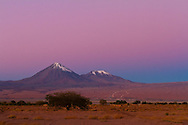 The pinkish Belt of Venus twilight glow is here above the dark blue band of Earth's shadow, all behind the mountainscape of the Andes and the conical peak of Licancabur Volcano, 5900 metres high. This was with the Canon 7D camera and 50mm Sigma lens. Colour saturation has been increased to bring out the colour contrast. Taken from Atacama Lodge, San Pedro de Atacama, Chile, May 2011.