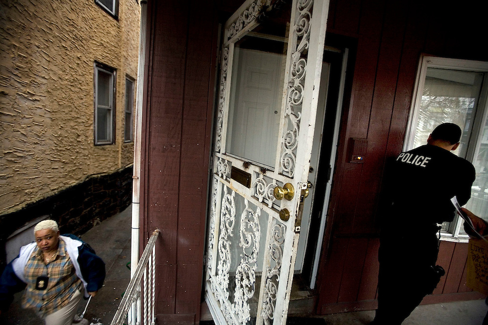 Philadelphia Police Detectives Michelle Haines, left, and Robert Penn try to serve a warrant in South Philadelphia on Friday, Feb. 3, 2006. Photo by Ryan Donnell