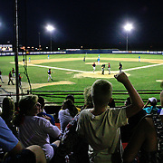 The Clarinda A's fans come to life as their team routs the Omaha Diamond Spirit, 9-1 in a June game at Municipal Stadium.  photo by David Peterson