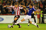 London - Tuesday, 21st September, 2010: Charlie MacDonald of Brentford and Leon Osman of Everton during the Carling Cup 3rd Round match at Griffin Park, London...Pic by: Alex Broadway/Focus Images