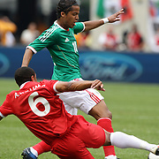 Giovani Dos Santos, Mexico, is tackled by Ashley Williams, Wales, during the Mexico V Wales international football friendly match at MetLife Stadium, East Rutherford, New Jersey, 23rd May 2012. Photo Tim Clayton