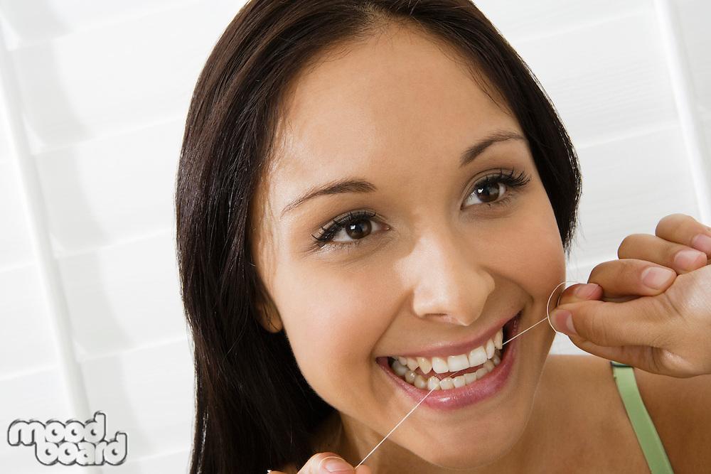 Woman using dental floss