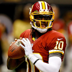 September 9, 2012; New Orleans, LA, USA; Washington Redskins quarterback Robert Griffin III (10) warms up prior to kickoff of a game against the New Orleans Saints at the Mercedes-Benz Superdome. Mandatory Credit: Derick E. Hingle-US PRESSWIRE