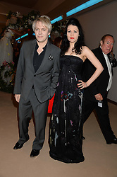 NICK RHODES and NEFER SUVIO at the Masterpiece Midsummer Party in aid of Marie Curie Cancer Care held at The Royal Hospital Chelsea, London on 2nd July 2013.
