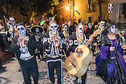 A mariachi band leads a procession of skeletons and La Calavera Catrina during the Day of the Dead festival November 1, 2016 in San Miguel de Allende, Guanajuato, Mexico. The week-long celebration is a time when Mexicans welcome the dead back to earth for a visit and celebrate life.