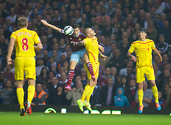 LONDON, ENGLAND - Saturday, September 20, 2014: Liverpool's Martin Skrtel in action against West Ham United's Stewart Downing during the Premier League match at Upton Park. (Pic by David Rawcliffe/Propaganda)