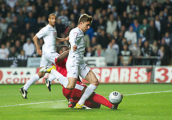 SWANSEA, WALES - Monday, May 15, 2011: Swansea City's Fabio Borini is brought down by Nottingham Forest's Wes Morgan during the Football League Championship Play-Off Semi-Final 2nd Leg match at the Liberty Stadium. (Photo by David Rawcliffe/Propaganda)