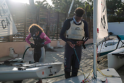 World Sailing Emerging Nations Program - Boca Chica Sailing Club, Santo Domingo 08/19/2017 - DAY 1- Jessee Jackson (right) and Allena Rankine from the Cayman Islands pack and clean their equipment after practice