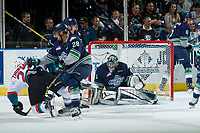 KELOWNA, CANADA - APRIL 26: Calvin Thurkauf #27 of the Kelowna Rockets is checked by Keegan Kolesar #28 in front of the net of Carl Stankowski #1 of the Seattle Thunderbirds on April 26, 2017 at Prospera Place in Kelowna, British Columbia, Canada.  (Photo by Marissa Baecker/Shoot the Breeze)  *** Local Caption ***