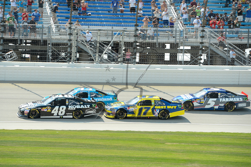 Joliet, IL - SEP 16, 2012: Jimmie Johnson (48), Matt Kenseth (17) and Kasey Kahne (5) race side by side during the Geico 400 at the Chicagoland Speedway in Joliet, IL.