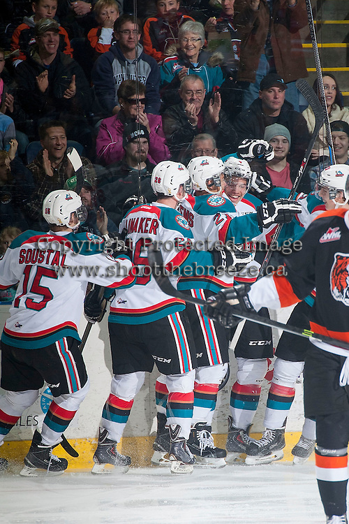 KELOWNA, CANADA - JANUARY 10: Madison Bowey #4, Devante Stephens #21, Cole Linaker #26 and Tomas Soustal #15 of Kelowna Rockets celebrate a goal against the Medicine Hat Tigers on January 10, 2015 at Prospera Place in Kelowna, British Columbia, Canada.  (Photo by Marissa Baecker/Shoot the Breeze)  *** Local Caption *** Madison Bowey; Devante Stephens; Cole Linaker; Tomas Soustal;