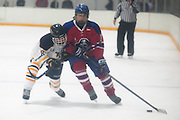 Victor's Max Lambert and Fairport's Cameron Krug fight for a puck during a scrimmage at Thomas Creek in Fairport on Monday, November 24, 2014.