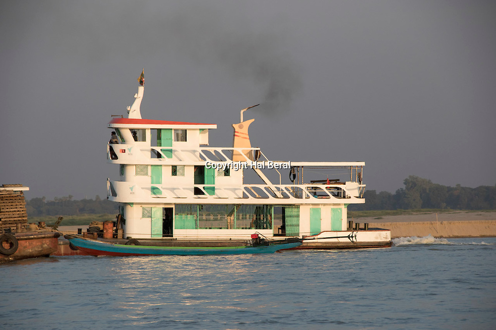 Tugboat pushs a cargo barge on the Ayeyarwady River<br /> Bagan,Myanmar