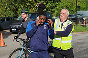 AFC Wimbledon attacker Michael Folivi (17) arriving for the game and having his hat stolen by security during the EFL Sky Bet League 1 match between AFC Wimbledon and Portsmouth at the Cherry Red Records Stadium, Kingston, England on 19 October 2019.