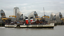 © Licensed to London News Pictures. 05/10/2013. Paddlesteamer Waverley approaches the Thames Barrier with the O2 in the background. The Waverley is the last seagoing paddle steamer in the world and is currently on her autumn season of excursions on the Thames. Credit : Rob Powell/LNP