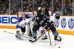 April 4, 2011; San Jose, CA, USA;  San Jose Sharks center Jamal Mayers (10) skates with the puck in front of Los Angeles Kings goalie Jonathan Quick (32) during the first period at HP Pavilion. Mandatory Credit: Jason O. Watson / US PRESSWIRE