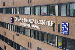 View of front of Queen's Medical Centre showing hospital's name and logo,