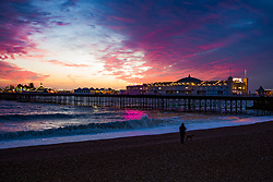 © Licensed to London News Pictures. 07/12/2017. Brighton, UK. A colourful sunset in Brighton and Hove after a whole day of wind and rain by storm Caroline. Photo credit: Hugo Michiels/LNP