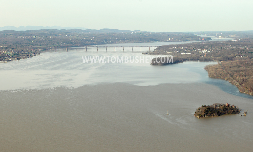 Cornwall, New York - A view of the Hudson River looking north from Storm King Mountain State Park on March 27, 2010. Bannerman's Island Arsenal on Pollepel Island is at lower left. The Newburgh Beacon Bridge is visible crossing the river.