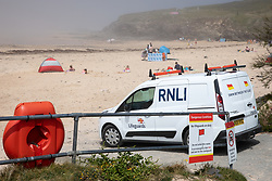 © Licensed to London News Pictures. 27/05/2020. Padstow, UK. An RNLI van overlooks Harlyn Bay, Cornwall as a sea mist engulfs the beach. On Monday, a man died after getting into difficulty in the sea between nearby Constantine Bay and Treyarnon Bay. A teenage girl also died after being trapped in a capsized rigid inflatable boat near Padstow. Multiple other beach related incidents are being reported daily. Due to Coronavirus (COVID-19), the RNLI are currently not operating a Lifeguard service on the beaches in Cornwall, as there would be normally at this time of year. Photo credit : Tom Nicholson/LNP