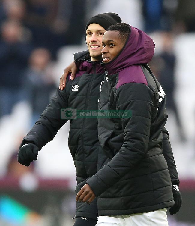 West Ham United's Marko Arnautovic (left) and Edimilson Fernandes celebrating after the game