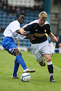 Dundee v Millwall. Pre-season Friendly, Dens Park, Dundee<br /> <br /> Millwall's Toamani Diagouraga tries to stop Dundee's Kevin McDonald