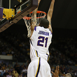 14 February 2009 LSU center Chris Johnson (21) dunks over Malcolm White (21) of Ole Miss during 73-66 win by the LSU Tigers against SEC rival the Ole Miss Rebels at the Pete Maravich Assembly Center in Baton Rouge, LA.