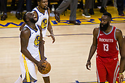 Golden State Warriors forward Draymond Green (23) celebrates a foul called on Houston Rockets guard James Harden (13) during Game 3 of the Western Conference Finals at Oracle Arena in Oakland, Calif., on May 20, 2018. (Stan Olszewski/Special to S.F. Examiner)