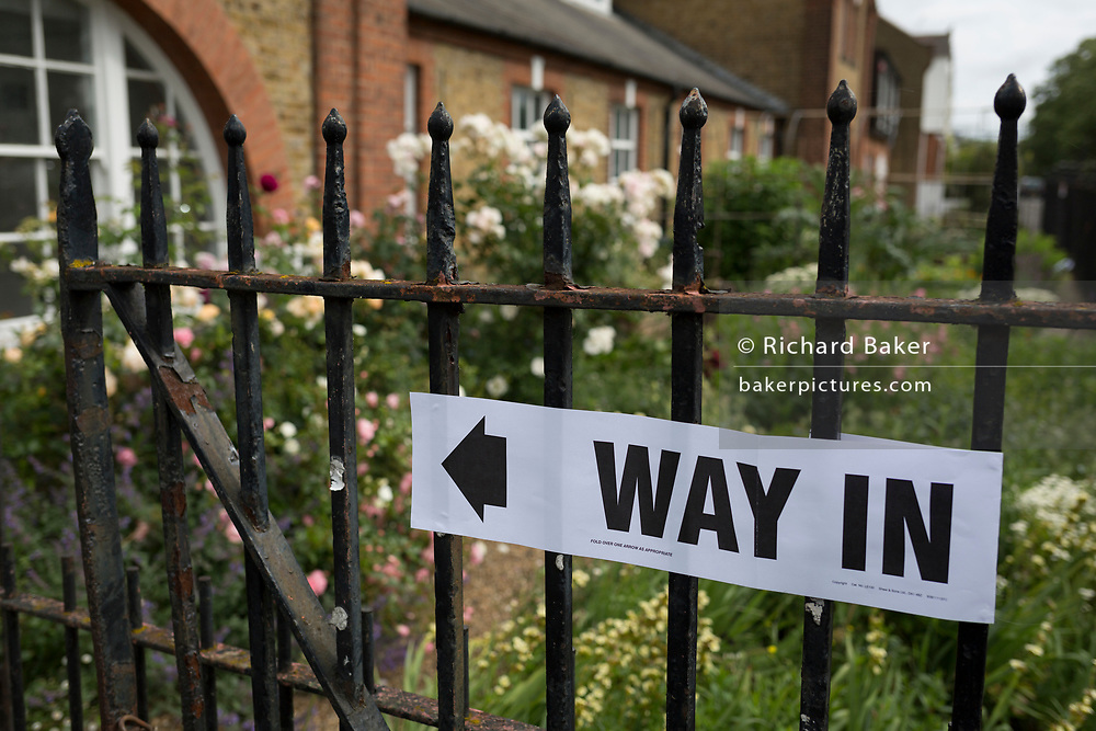 The way in to the polling station on the morning of the UK 2017 general elections outside tSt. Saviour's Parish Hall in Herne Hill, Lambeth, on 8th June 2017, in London, England.