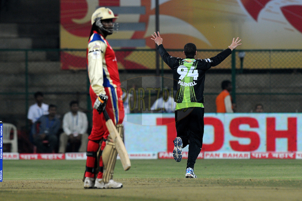 Wayne Parnell of Warriors celebrates  a wicket during match 1 of the NOKIA Champions League T20 ( CLT20 )between the Royal Challengers Bangalore and the Warriors held at the  M.Chinnaswamy Stadium in Bangalore , Karnataka, India on the 23rd September 2011..Photo by Pal Pillai/BCCI/SPORTZPICS