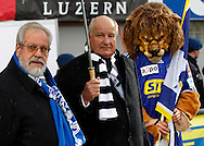 FC Luzern president Walter STIERLI (C) presents former player Paul WOLFISBERG (L), who played his first match 60 years ago, with a special jersey prior to the AXPO Super League (National League A) soccer match between FC Luzern (FCL) and FC Basel (FCB) at the Gersag stadium in Emmenbruecke, Switzerland, Sunday, February 27, 2011. (Photo by Patrick B. Kraemer / MAGICPBK)
