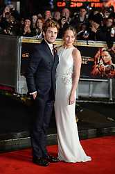 Sam Claflin with Laura Haddock arrive for The Hunger Games: Catching Fire premiere, Leicester Square, London, United Kingdom. Monday, 11th November 2013. Picture by Andrew Parsons / i-Images