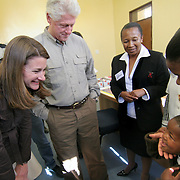 July 13, 2006 - Six-year-old Arriet, who is HIV positive, healthy, and on ARV's, meets President Clinton and Melinda Gates hand during a visit to the antiretroviral treatment center, Karabong Clinic, at Mafeteng Hospital in Lesotho. Arriet was among the first group of children to receive ARV treatment donated by the Clinton Foundation in 2004. Phto by Evelyn Hockstein