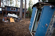 SOMERSET, CA - DECEMBER 2:  A foreclosed home awaits clean-up in Somerset, California December 2, 2008. Many foreclosed homes need substantial repairs and trash removal before going on the market. (Photo by Max Whittaker/Getty Images)