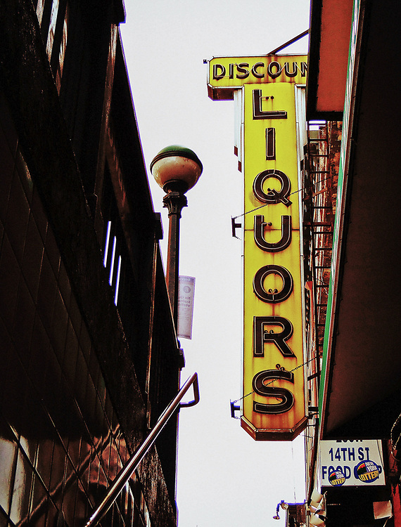 Yellow Discount liquors sign at 14th St subway. NYC 2010