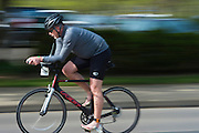 Bob Holm bikes during the O'Bleness Race for a Reason Triathlon Saturday, April 27, 2013. The triathlon included a 500mm Serpentine Swim at the Ohio University Aquatic Center, a 15 mile bike ride to the Plains and back and then a 5k run that finished at Tailgreat Park across from Peden Stadium. . Race for a Reason, Race 4 A Reason, Annual Events, Events, Students, Faculty & Staff