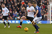 Birmingham City FC midfielder Maikel Kieftenbeld and Derby County midfielder Jeff Hendrick challenge for the ball during the Sky Bet Championship match between Derby County and Birmingham City at the iPro Stadium, Derby, England on 16 January 2016. Photo by Aaron Lupton.