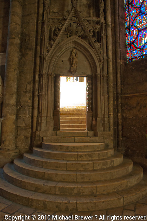 Our Lady of Chartres Cathedral, Chartres, France. Rounded steps and arched doorway leading to the upper chapel.