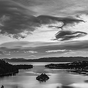 A black and white image of storm clouds above Emerald Bay, Lake Tahoe