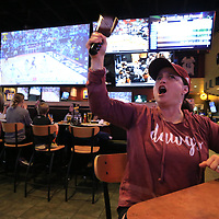 Thomas Wells | Buy at PHOTOS.DJOURNAL.COM<br /> Michelle Dulaney of Tupelo cheers on her Miississippi State women's basketball team with her cowbell as she watches the NCAA National Championship game at Buffalo Wild Wings in Tupelo Sunday.