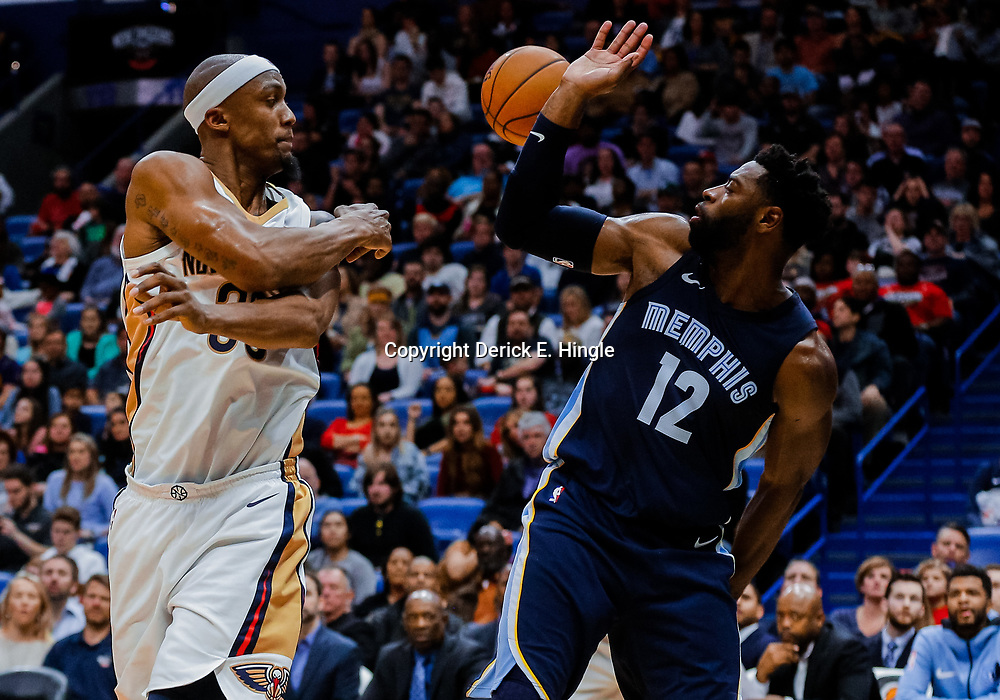 Jan 20, 2018; New Orleans, LA, USA; New Orleans Pelicans forward Dante Cunningham (33) with the assist to guard E'Twaun Moore for a three point basket as Memphis Grizzlies guard Tyreke Evans (12) defends during the second half at the Smoothie King Center. The Pelicans defeated the Grizzlies 111-104. Mandatory Credit: Derick E. Hingle-USA TODAY Sports