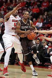 29 December 2014:  Ja'mil Jones protects possession as he heads in past Will Ransom during an NCAA non-conference interdivisional exhibition game between the Quincy University Hawks and the Illinois State University Redbirds at Redbird Arena in Normal Illinois.